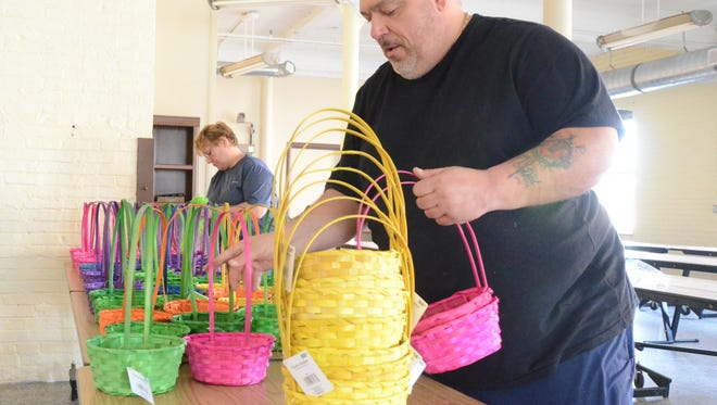 Alphonse Bifulco and Tina Fleming have about 100 Easter baskets to fill by this weekend so they can distribute them to children in Battle Creek.