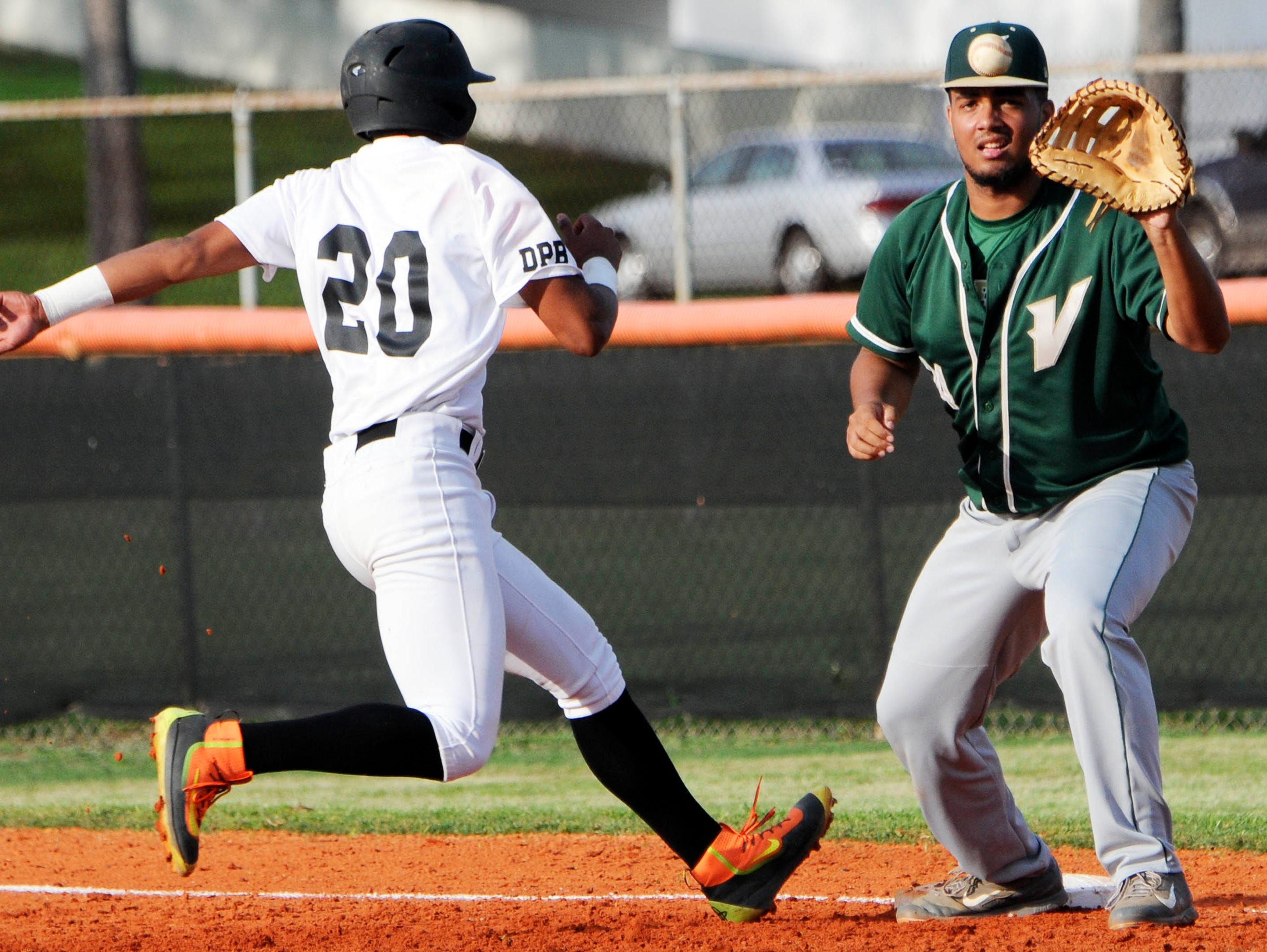 Luis Curbelo of Cocoa gets back to first before the pickoff throw to Viera first baseman Sebastian Samuels Wednesday evening.