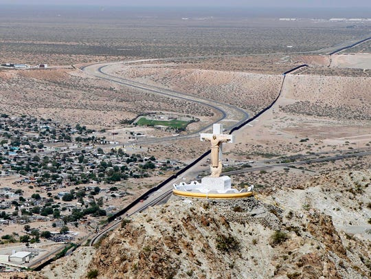 A statue of Christ stands atop Mount Cristo Rey in