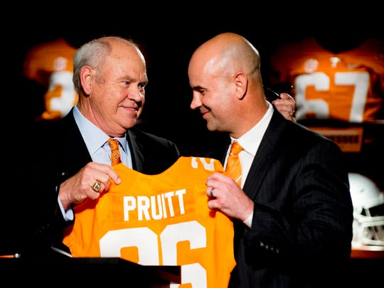University of Tennessee Athletic Director Phillip Fulmer, left, introduces Jeremy Pruitt during his introduction ceremony as Tennessee's next head football coach at the Neyland Stadium Peyton Manning Locker Room in Knoxville, Tenn. on Thursday, December 7, 2017.