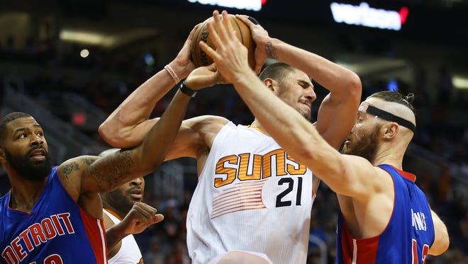 Phoenix Suns' Alex Len battles for the rebound with Detroit Pistons Marcus Morris and Aron Baynes (right) in the second half on Nov. 9, 2016 in Phoenix, Ariz.