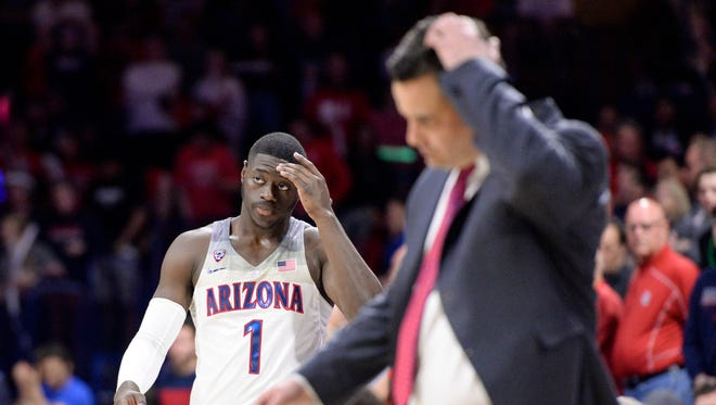 Feb 8, 2018; Tucson, AZ, USA; Arizona Wildcats guard Rawle Alkins (1) and head coach Sean Miller walk on to the court during a timeout during the second half against the UCLA Bruins at McKale Center. Mandatory Credit: Casey Sapio-USA TODAY Sports