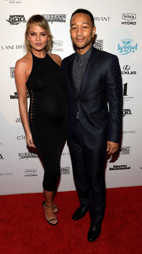 Chrissy Teigen and John Legend attend the Sports Illustrated