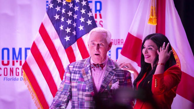 Republican congressional candidate Laura Loomer celebrates with Roger Stone at an election night event Tuesday at the airport Hilton in West Palm Beach.