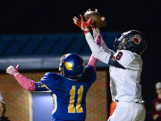 Belton-Honea Path junior Zy Scott(8) catches a pass near Wren senior Tyrese Franklin(11) for a touchdown during the third quarter at of the Region 1-AAAA game at Wren High School in Piedmont on Friday.
