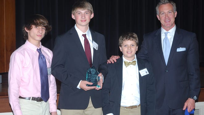The late Elmer Higginbotham, who coached at Jones County Junior College from 1971-92, was inducted into the Mississippi Community and Junior College Sports Hall of Fame on April 28. Accepting the award from JCJC President Dr. Jesse Smith (right) were Coach Higginbotham's grandsons (from left to right) Brock Walley, Tanner Boleware and Hunter Boleware.