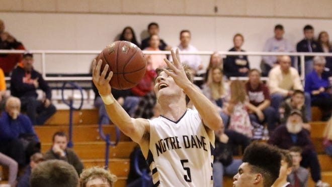 Gary Raupers of Elmira Notre Dame goes up for a shot against Odessa-Montour in a 68-40 win Jan. 12 at Notre Dame.