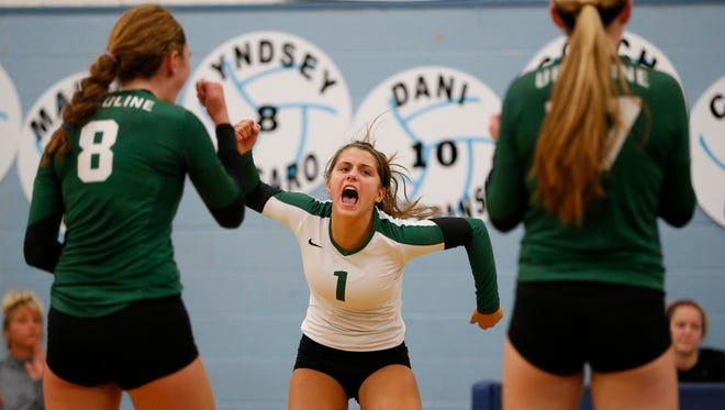 Ursuline's Avery Naylor celebrates a point with her teammates against Mount Notre Dame during their volleyball match last year. She returns for UA this fall.