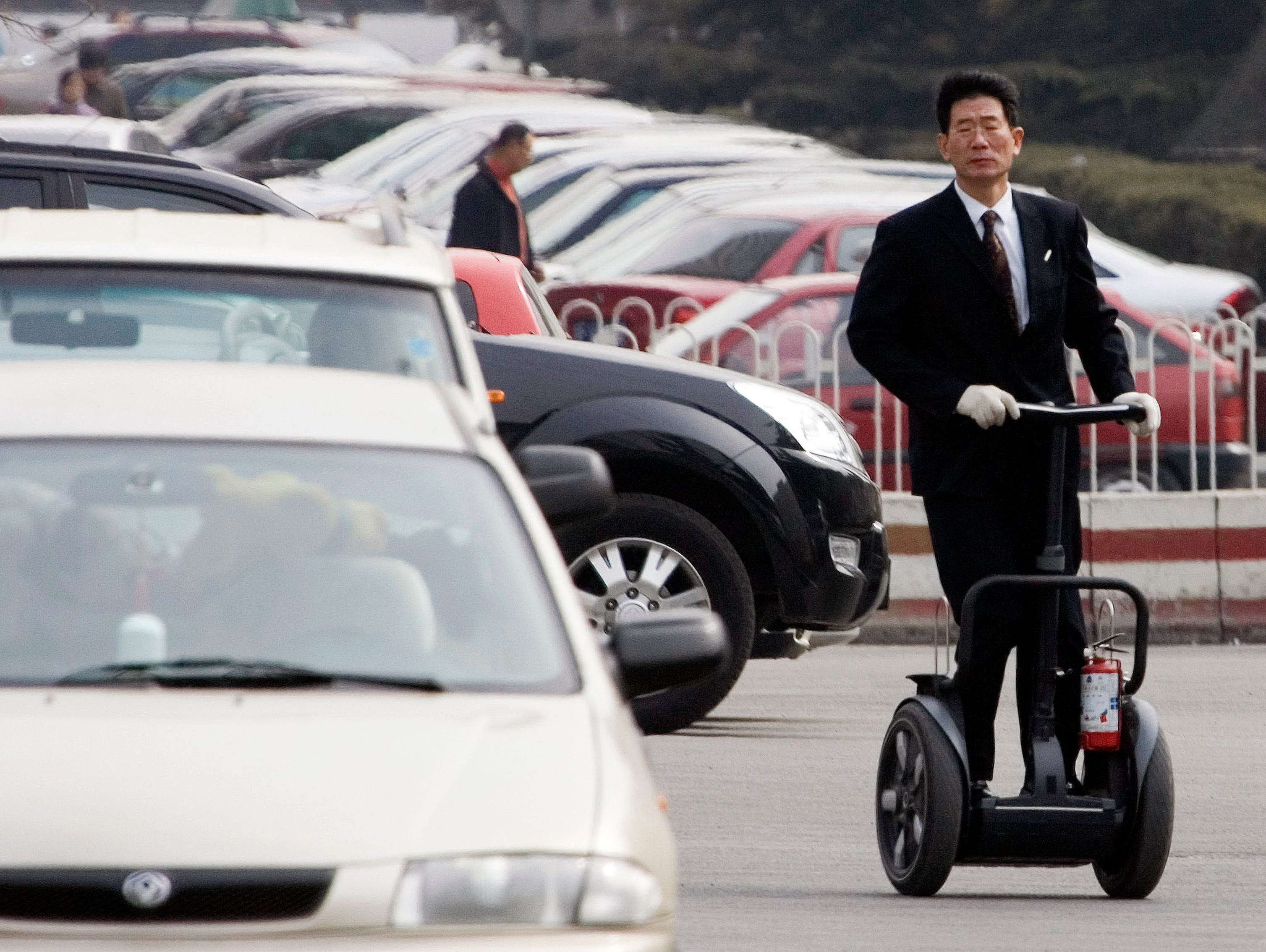 A man rolls on a Segway during his practice at a parking lot of a club where he sells the personal transporter in Beijing.