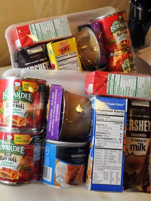 Packages of food like these go home with kids who are helped by The Children's Hunger Project.