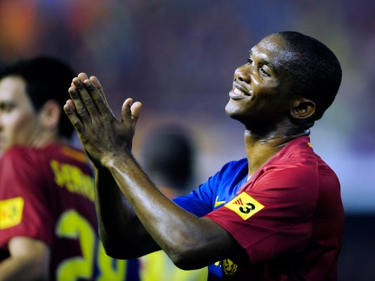 FILE - In this May 13, 2009 file photo, FC Barcelona's Samuel Eto'o of Cameroon reacts during the Copa del Rey final match at the Mestalla stadium in Valencia, Spain. Spanish prosecutors are seeking a 10-year prison term for former Barcelona striker Samuel Eto'o for alleged tax crimes committed when he played for the Catalan club. (AP Photo/Manu Fernandez, File)
