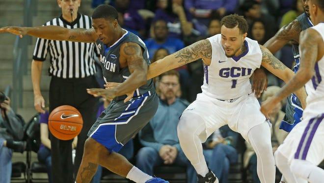 Grand Canyon University's Grandy Glaze (1) knocks the ball away from Hampton's Reginald Johnson, Jr. at GCU Arena on Nov. 30, 2015 in Phoenix.