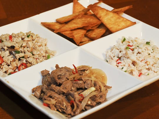 A trio of some of Guam's most popular kelaguen. From left, chicken, beef and shrimp served with fried tatiyas.