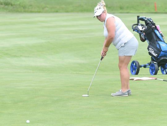 Mountain Home's Haley Czeschin watches her putt Wednesday