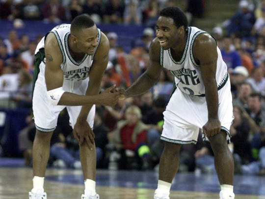 Morris Peterson and Mateen Cleaves celebrate at mid-court