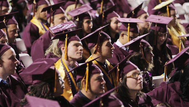 Arizona State University graduates watch the graduation ceremony at Sun Devil Stadium in Tempe in 2012.