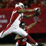 Atlanta Falcons free safety Dwight Lowery (20) defends as Arizona Cardinals wide receiver Michael Floyd (15) makes the catch during the first half Sunday.