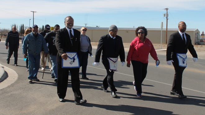 Members of the Prince Hall Mason Lodge in Alamogordo march in the Martin Luther King Jr. Day memorial march Monday afternoon.