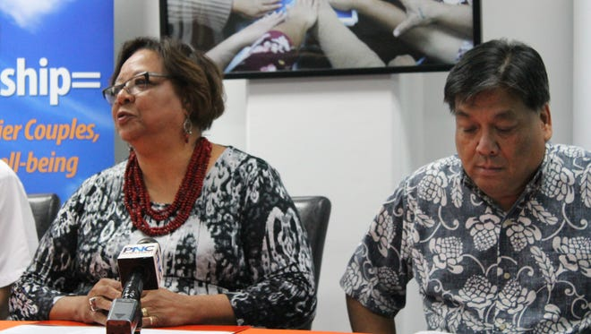 Sarah Thomas-Nededog, left, Senior Vice President of WestCare Pacific Islands, and Juan Flores, former education superintendent who is WestCare's regional vice president, attend a press conference in Hagåtña Dec. 19, 2017,announcing WestCare has been accredited for three years.