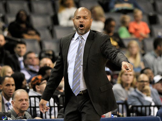 Memphis Grizzlies interim coach J.B. Bickerstaff calls to players during the first half of the team's NBA basketball game against the Denver Nuggets on Friday, March 2, 2018, in Memphis, Tenn. (AP Photo/Brandon Dill)