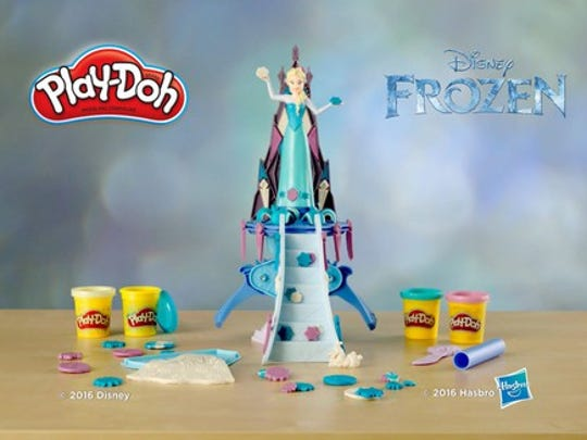 The princess Elsa character from Disney's movie Frozen atop a slide in a Hasbro Play-Doh brand advertisement