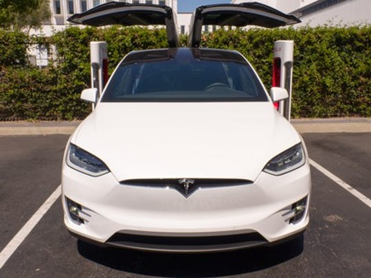Model X with falcon wing doors open