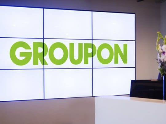 "Nine screens spelling out ""Groupon"" at the company's office entrance."
