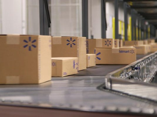 walmart-e-commerce-fulfillment-center-boxes-being-shipped_large.jpg