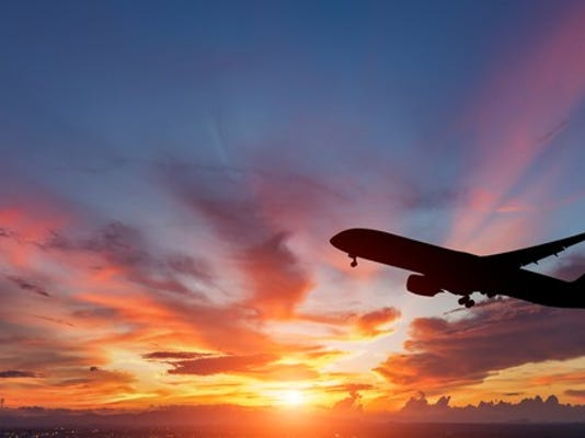 airplane-flying-in-sunset_large.jpg