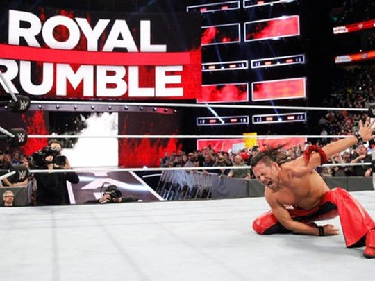 WWE wrestler Shinsuke Nakamura striking a celebratory pose at Royal Rumble 2018.