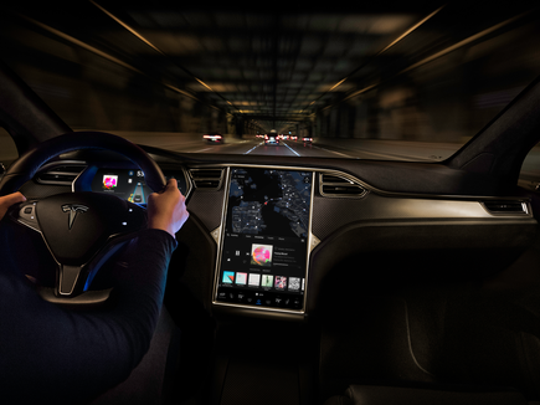 Tesla's Autopilot is a partially self-driving system that enables the car to brake, accelerate and stay in its lane on streets with marked lanes.