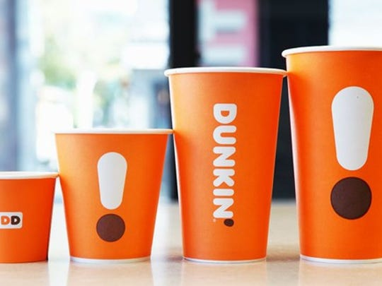 Line-up of new orange, minimilalistic Dunkin' coffee cups.