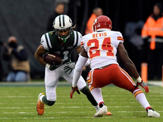 New York Jets wide receiver Robby Anderson (11) completes a pass with coverage from Kansas City Chiefs defensive back Darrelle Revis (24), a former Jet. Kansas City Chiefs at the New York Jets in East Rutherford, NJ on Sunday, December 3, 2017.