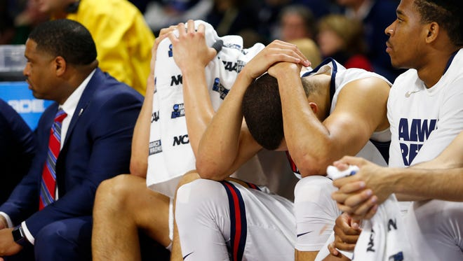Arizona Wildcats center Kaleb Tarczewski and forward Ryan Anderson show their frustration after losing to Wichita State.