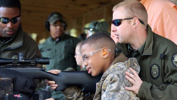 Mississippi Wildlife Fisheries and Parks officers helping kids with disabilities during Super Hunt weekend.