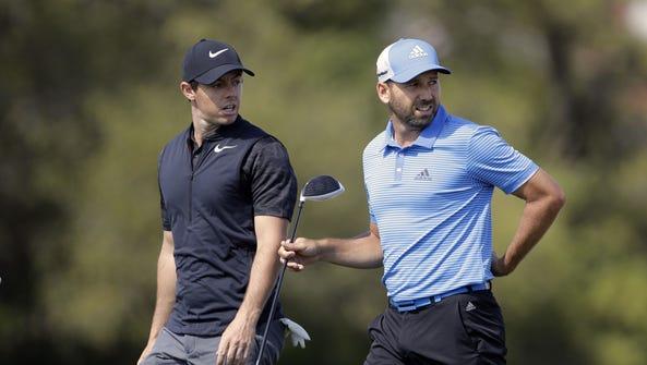 Rory McIlroy, of Northern Ireland, left, and Sergio