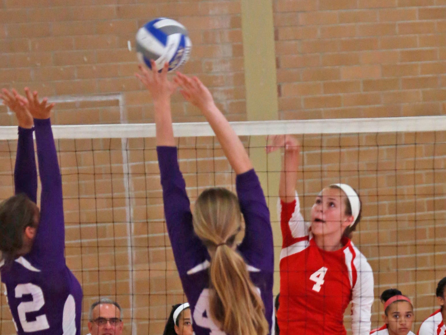 North Rockland's Madison Monahan (4) returns to New Rochelle's Madeline Smith (42) during the game at North Rockland High School in Thiells on Sept. 2, 2014. New Rochelle won the first two sets.