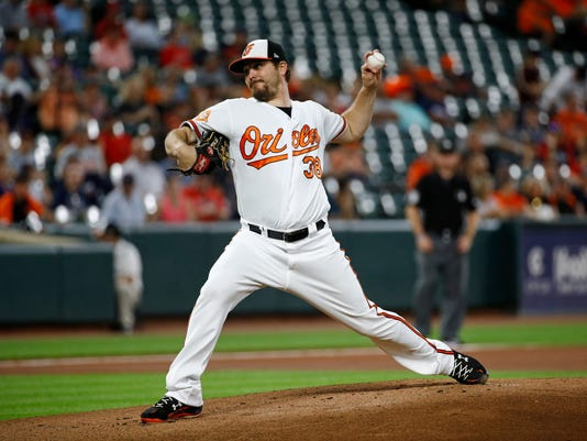 Baltimore Orioles starting pitcher Wade Miley throws to the Boston Red Sox in the first inning of a baseball game in Baltimore, Wednesday, Sept. 20, 2017. (AP Photo/Patrick Semansky)