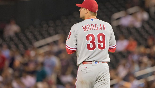 Phillies starting pitcher Adam Morgan looks on after giving up two runs against the Minnesota Twins in the fifth inning at Target Field.