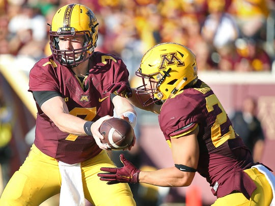 Minnesota quarterback Mitch Leidner (7) hands the ball to running back Shannon Brooks in the fourth quarter against Ohio at TCF Bank Stadium in Minneapolis on Saturday, Sept. 26, 2015. Minnesota won, 27-24.