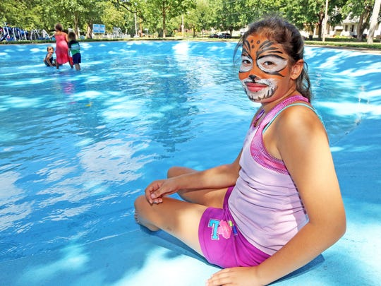 Cecilia McKelvey, 11, of Des Moines enjoys the wading