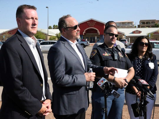 Juan Cabrera, center, El Paso school district superintendent speaks to the media outside Tippin Elementary School with school board president Trent Hatch, left, and school district police chief Victor Araiza and other officials Tuesday morning.