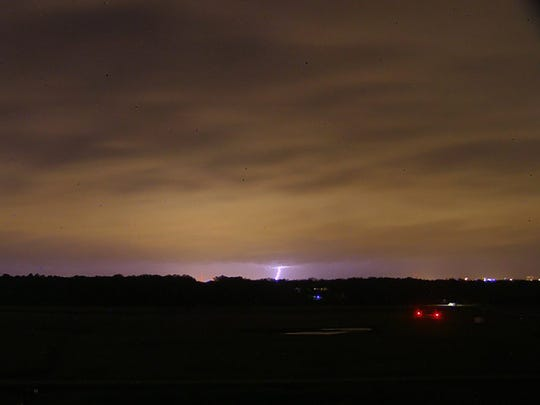 A cloud to ground lightning strike is seen from the National Weather Service Jackson, Miss. tower during approaching storms Tuesday night.