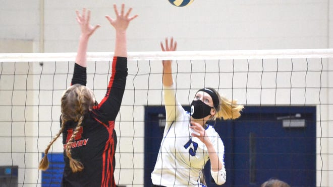 Inland Lakes senior Ashla DeWyre (13) looks to put a ball over Onaway junior Lexi Horton (left) during the second set of a MHSAA Division 4 regional semifinal contest in Wolverine on Tuesday.