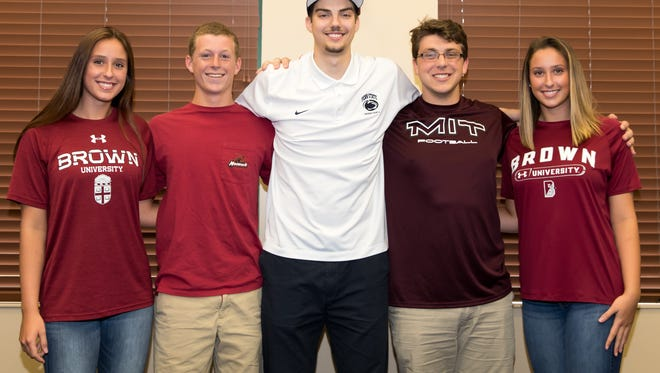 Community School athletes pose for a picture on Tuesday, April 18, 2017, after signing national letters of intent to play their sports in college. From left to right: Camberly Moriconi (Brown, volleyball), Brendan Miles (Norwich, lacrosse), Trent Buttrick (Penn State, basketball), Cory Hixson (MIT, football), Gabrielle Moriconi (Brown, volleyball)