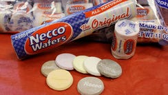 Necco Wafers are displayed in Boston. Four bidders