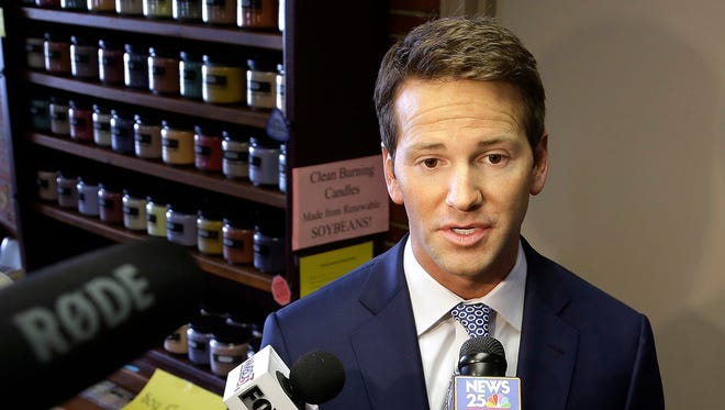 Rep. Aaron Schock, R-Ill. speaks to reporters in Peoria, Ill.