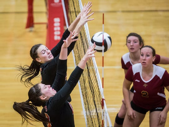 Wapahani's Annie Schuck and Chase Curry block an attack