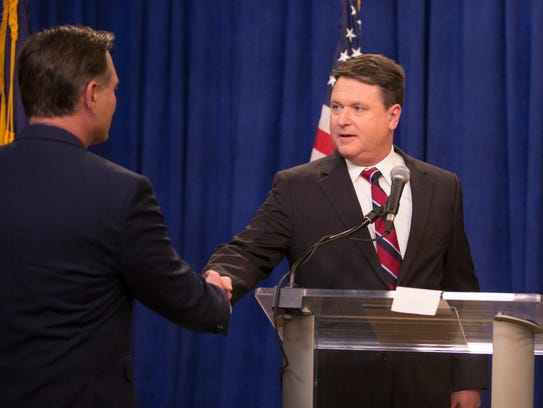 Luke Messer (left), shakes the hand of Todd Rokita,
