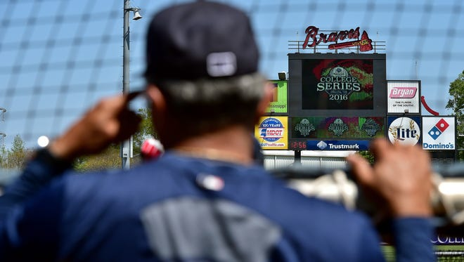 Mississippi Braves manager Luis Salazar watches batting practice Tuesday at Trustmark Park in preparation for Thursday night's season opener against the Pensacola Blue Wahoos.